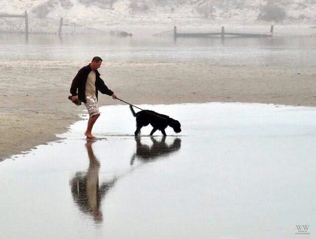 Man and his dog at the lagune