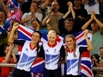 Dani King, Joanna Rowsell, and Laura Trott of Great Britain celebrate winning the gold medal