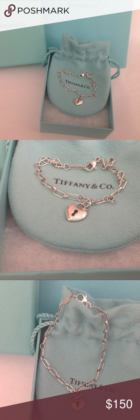 """SALE☃️Tiffany & Co Mini Heart Lock Bracelet Authentic sterling silver Tiffany mini heart lock bracelet. Measures 7"""" so it is a better fit for small wrists.  Very cute and dainty and in excellent used condition, with minor signs of wear, ( if any ).  Includes the Tiffany box and pouch. 🚫NO TRADES🚫 SALE PRICE IS FIRM, NOT ACCEPTING OFFERS. Tiffany & Co. Jewelry Bracelets #SterlingSilverTiffanyJewelry"""