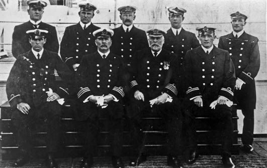 The officers of the Titanic, with Capt. Smith, second from the right in front row.  (White beard)