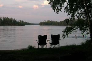 Pull up a chair - waterside - in Virginia. Check out this list of 10 Virginia camping destinations that let you dip your toes in and chill out. Image: Lake Shore Campground, Abingdon