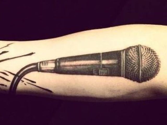 Let's start with an easy one. Who does this famous microphone tattoo belong to?