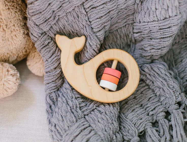 The whale rattle is one of our newest rattles, and happens to match the whale teether! This rattle is organic and natural. The whale is made in light Maple wood and finished with our own...
