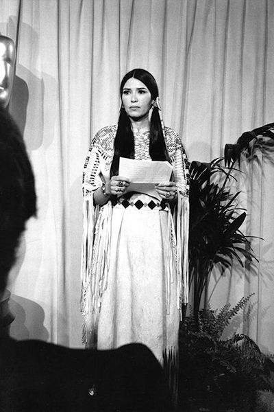 OSCAR MOMENTS.  (1973):  Marlon Brando won best actor for his iconic portrayal of Don Corleone in The Godfather. But he refused to accept the award, and instead sent a woman who said she was an Apache named Sacheen Littlefeather to speak on his behalf. Brando was protesting what he believed to be stereotypical treatment of Native Americans in the film industry. Littlefeather's speech drew a mixture of applause and boos, as well as questions about whether she was truly a Native American…