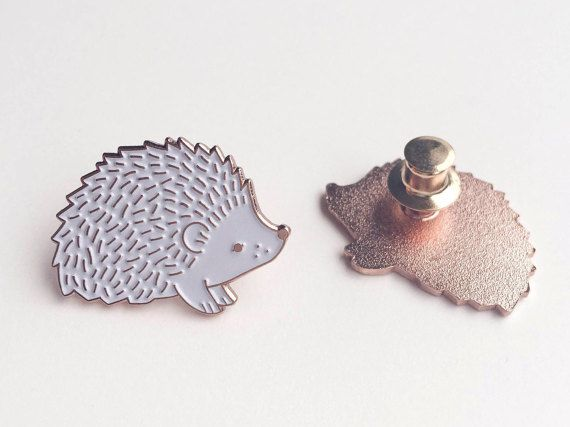 This Hedgehog pin is a limited edition pin from my Wild Charms collection.  My cute, tender, white enamel pin made is made from rose gold enamel. How pretty! It was made after my original hedgehog illustration.  D E S I G N ➳ Rose gold enamel pin measures 3 cm in width ➳ Back side - deluxe clutch  S H I P P I N G ➳ Each Hedgehog pin comes on a special card and is wrapped in a bubble wrap and placed in a protected envelope to make sure it reaches you in perfect condition.  I hope you will…