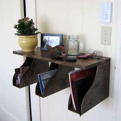 "Clever storage idea with multiple potential uses at front or back door: mail, keys, famous ""stuff not to forget on the way out"", gloves, soft hats, scarves, and so on. With a mirror above the shelf to check your self on the way out this is perfect for small spaces.(The vertical shelves are wooden office file storage, watch for them at garage sales!)"