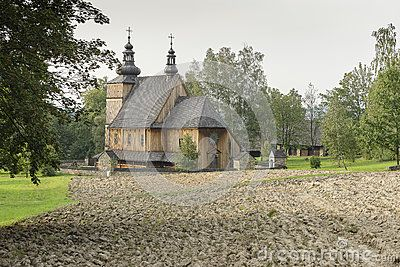 Old wooden Orthodox Catholic Church in open-air museum in Nowy Sącz and ploughed…