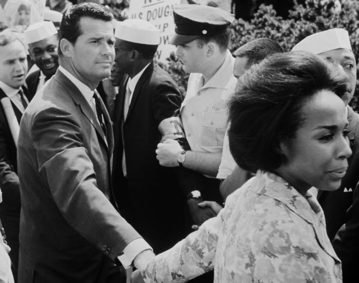 Actress Diahann Carroll holds the hand of fellow actor James Garner during the March on Washington on Aug. 28, 1963.