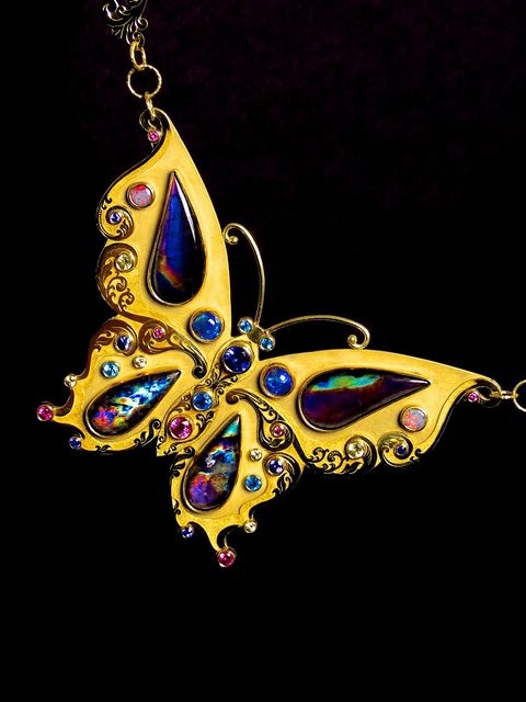 18k gold & 22k gold hand engraved butterfly pendant with spectrolite, black opal, white crystal opal, tanzanite, pink sapphire, yellow sapphire and apatite. By Jessica Dow and Mark Anderson of Different Seasons Jewelry.