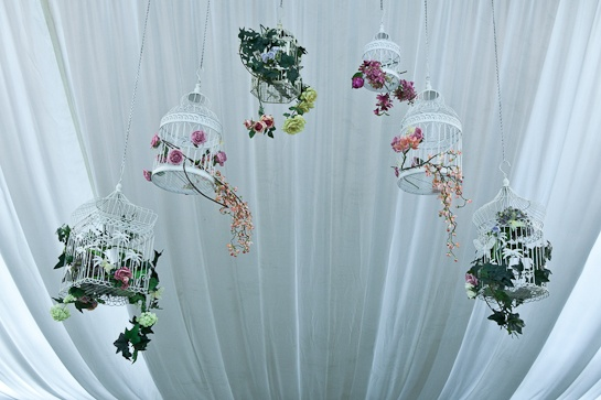 wedding birdcages decorated with flowers