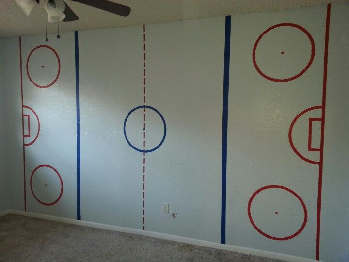Ice Hockey wall..My wonderful husband painted this on our son's wall.