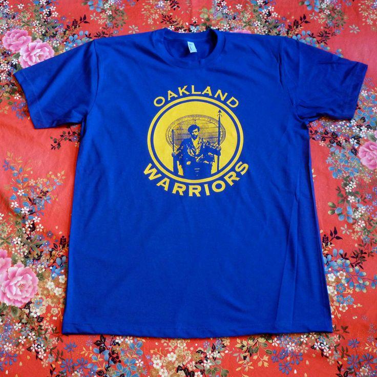 Oakland Warriors Huey Tee in Gold on Blue / ORUNDIDE