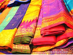 Not 100% sure that this is the original source of the image, but the photo gallery of the shop itself suggests it could be!  (Saris... fluorescent light... what's wrong with this picture?): Colour, Color, Bohemian Sky, Indian Silk, Indian Fabric, Indian Saree