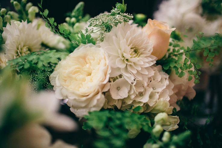 Detail of bridesmaid bouquet - white dahlia, white ranunculus, white hydrangea , white snapdragons , bupleurum and maiden hair fern.