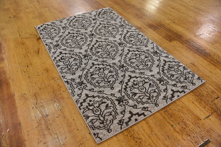 "This Turkish Damask rug is made of Polypropylene. This rug is easy-to-clean, stain resistant, and does not shed.  Colors found in this rug include: Beige, Brown. The primary color is Beige.  This rug is 1/2"" thick."