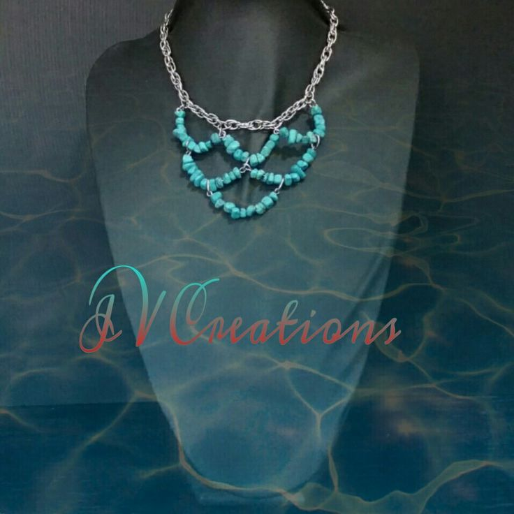 Turquoise beads on silver plated chain.