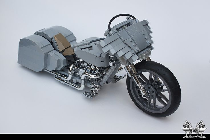 https://flic.kr/p/xGbf3y | Harley Davidson Custom 'Ratted' Bagger in Lego 1/10 | I love Harley Davidsons, especially the tricked out baggers. I have made a few of them as scale models, mostly heavily chromed and customized. After my last build I had some special chromed parts lying around for another bike, and decided to make a fresh one, but in a different style. I saw some nice new customs with special fairings, big front wheel, and low and agressive stand.