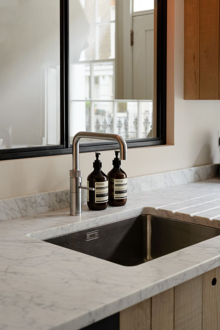 Honed Carrara marble sink counter in the the Marylebone London Galley by Simon Cox for DeVol | Remodelista