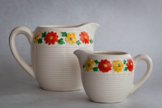 This little ceramic pitcher set from the 40s/50s is so cute and in great vintage condition! Dimensions: Big pitcher is 3 1/2in tall and 5