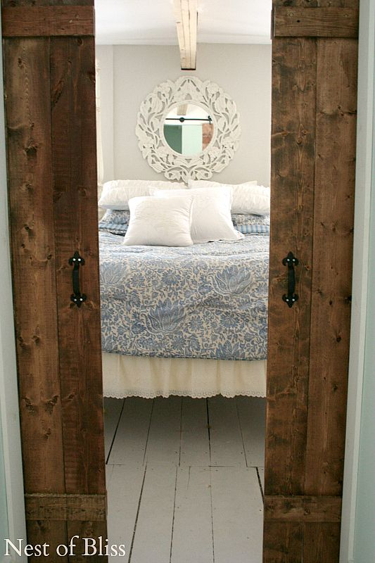 Create your own DIY sliding doors with this amazing tutorial that is easy and inexpensive to build! Made with a track of galvanized piping and clothesline spacers!