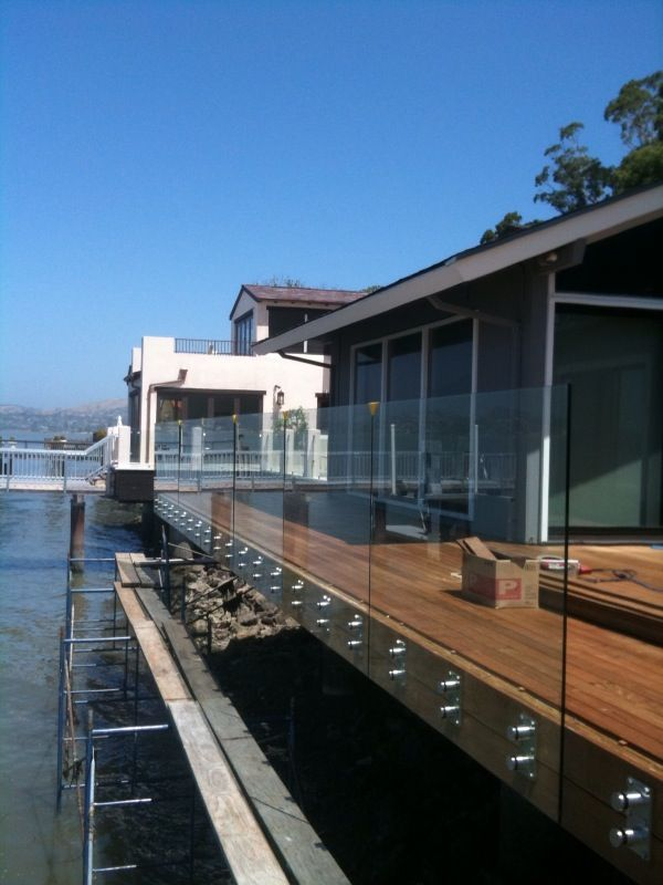 "Glass Deck Railing with CRL Standoffs and 1/2"" Tempered Glass.  Photo taken during installation prior to guardrail cap"