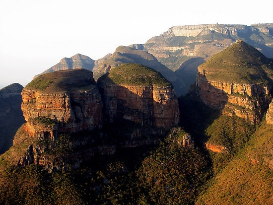 """The Three Rondavels across the Blyde Canyon at the end of the Panorama Route in #Mpumalanga, are huge triplet rock spirals rising out of the far wall of the canyon. The word """"Rondawel"""" is a South African word that refers to round dwellings with thatched roofs. The three well known gigantic peaks of quartzite and shale with their sheer rock walls tower more than 700m above the surrounding landscape.  Originally known as """"The Chief and his 3 wives in honour of Chief Maripe Mashile."""
