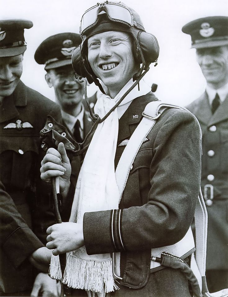 James 'Ginger' Lacey brought down more German aircraft than anyone else during the Battle of Britain with a tally of 18. In July 1940 he was awarded a parachute and scarf in recognition of his actions in bringing down a Heinkel which had bombed Buckingham Palace. He is photographed wearing the parachute and scarf made specially for him. The scarf bore all the names of the workers in Australia who made the parachute for him.