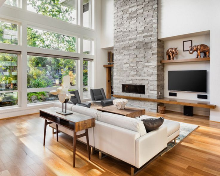 love the example of stone fireplace with wooden ledge.