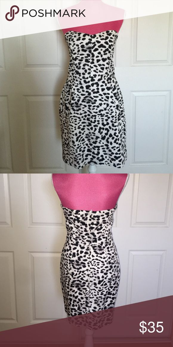 Strapless Animal Print Dress Black and white animal print. Has some stretch to it can be paired with a cardigan for work. Above the knee length H&M Dresses Strapless