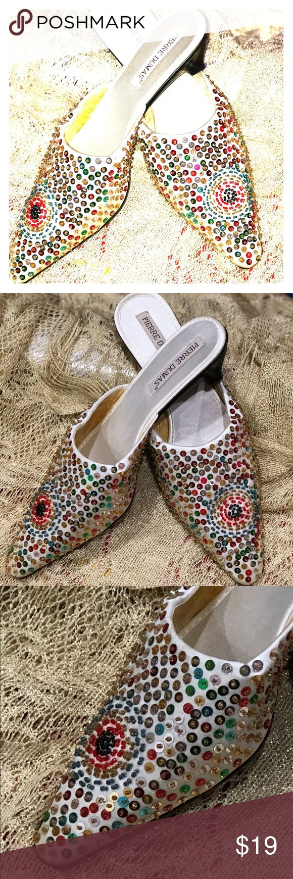 Sequined Shoes Pierre Dumas Size 8 NWT Pierre Dumas Vintage Sequin Shoes. Multi-color. Never been worn. The sequin has discolored the inside of the shoes but they are mint on the outside and no pieces are missing. Size 8 Women's Pierre Dumas Shoes Heels