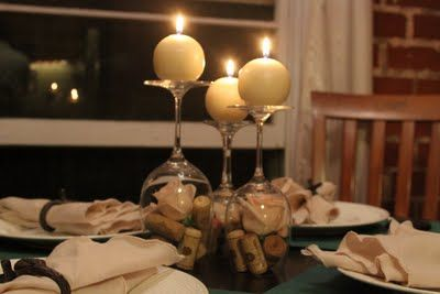 wine glass centerpiece - I love the round candles - pearls under glass would be pretty too