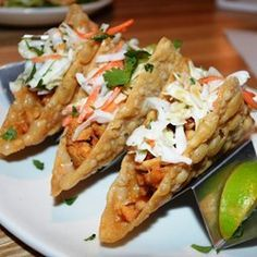 Chicken Wonton Tacos - Allrecipes.com- use yogurt instead of coleslaw dressing, olive oil instead of sesame oil and add red pepper flakes as desired for some heat.