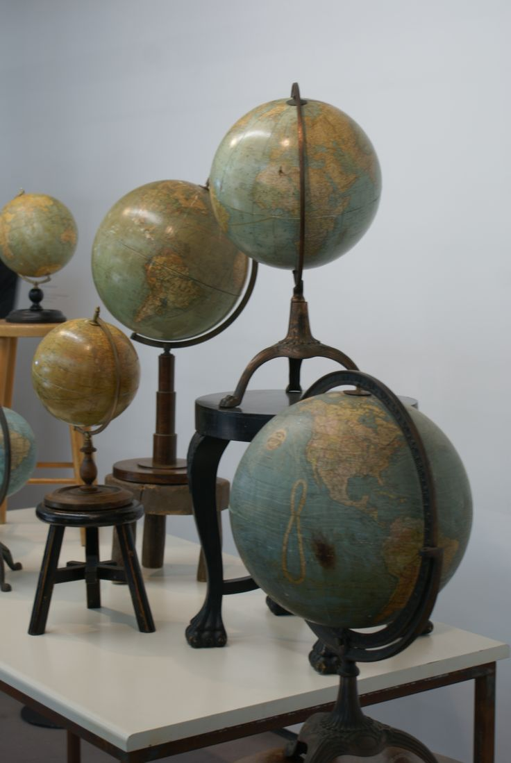 Not all who wander are lost, Bharti Kher / Wooden stools, table, mechanised antique globes - 2009-2010