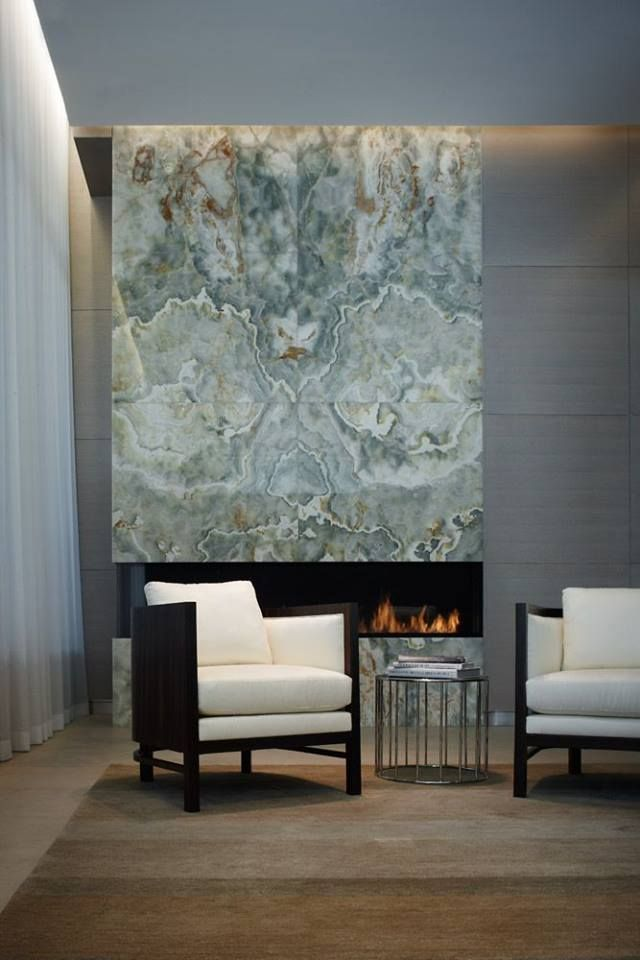 This living room exudes #SleekAndSexy design and radiates luxury with the addition of a marble slab fireplace.