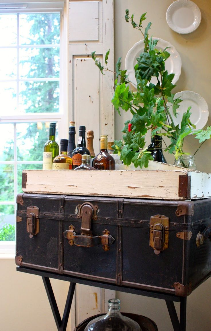 We love this simple way to create table top storage! Vintage suitcases can add lots of charm and are both decorative and practical.