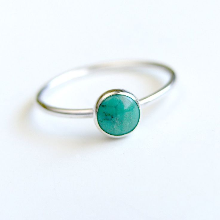 This beautiful, 6mm turquoise cabochon has been bezel set in a handmade ring of sterling silver. I have given the ring a shiny finish. Beautiful on its own or as a stacking ring.    This ring fits a size 7. I do have other tuquoise stones with their own unique matrix, if you would like to order a similar ring in another size please convo me