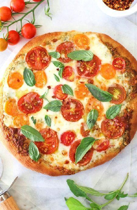 Low FODMAP Recipe and Gluten Free Recipe - Tomato, pesto and mozzarella pizza    http://www.ibs-health.com/low_fodmap_tomato_pesto_mozzarella.html