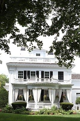 Old colonial with curtained porch....that;s actually a really cool idea.