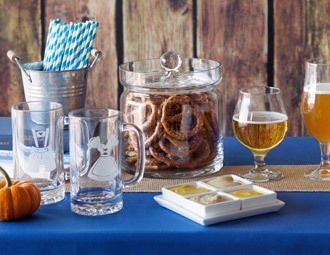 Tin bucket with bread, burlap and glass with pretzels, grapes