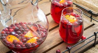Spiced Cranberry Sangria: Steep orange slices studded with cloves, cranberries and cinnamon sticks in sweet white wine and tart cranberry juice to create the perfect, delicately balanced holiday refreshment.