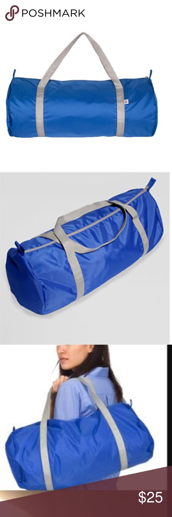 NWOT American Apparel Blue Nylon Sports/Gym Bag New Without Tag! A versatile bag, featuring nylon webbing straps and a nylon zipper closure. Water resistant build. Contrasting dual handles. Fabric: 100% Nylon. Blue with gray straps. American Apparel Bags