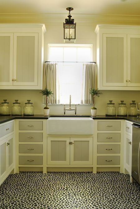 Neutral kitchen with two-tone painted cabinets. Not a fan of the floor; too dark and too busy
