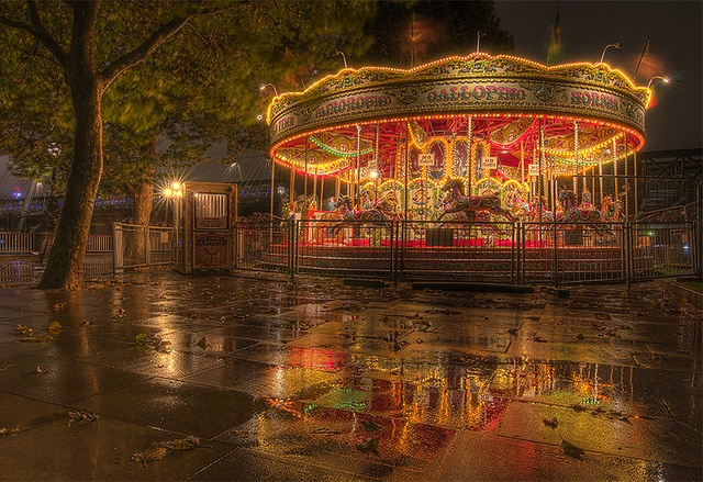The merry-go-round at Jubilee Gardens in London, England on a rainy night. On the south bank of the River Thames (or as they say in American, the Thames River, y'all)