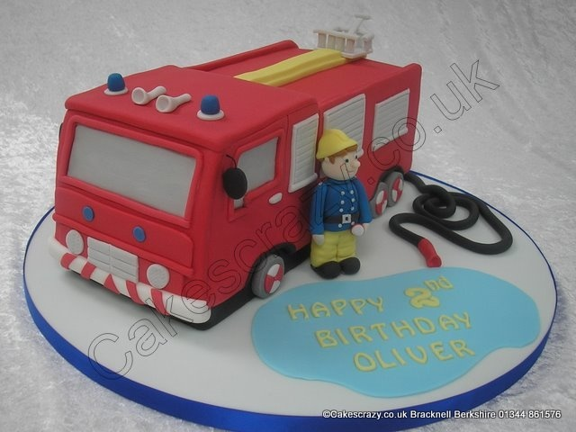 Fire Engine Cake. Blues and Two's. A fire engine shaped novelty cake with all the bells and whistles. Accompanied by fireman Sam himself who is taking a breather after extinguishing the flames