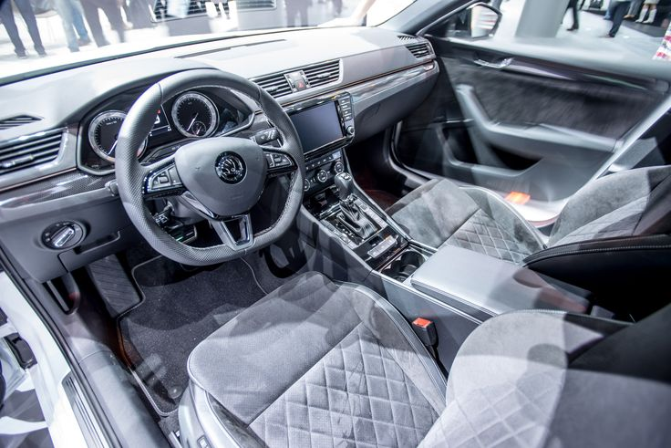Inside the car, the SportLine design has an array of sporty features, including a leather three-spoke sports steering wheel and gear knob, sport seats with exclusive seat covers, aluminium-look pedals and carbon-style trim #SKODAIAA #SuperbSportLine #SKODA #IAA2015