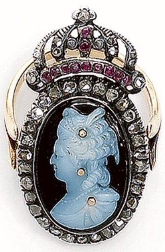 An antique Bague À Secret - Featuring a cameo with an image of Marie Antoinette highlighted with rose-cut diamonds, within a frame set with rose-cut diamonds, surmounted by a crown set with diamonds and rubies, mounted in silver, to a gold shank; the ring swivels to reveal a secret compartment. #antique #SecretRing