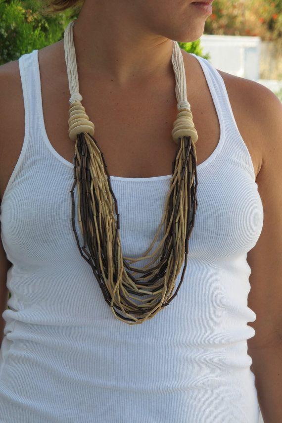 Long necklace with bamboo beads and white rope door WeAreIdiotech, €8.50 ...gar.en in nek.
