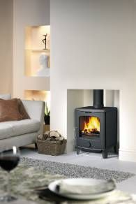 The 4-5 is the smallest stove in the scan Andersen   range and fits nicely into a UK style fire opening. Built in long lasting cast iron this stove produces a 4 kW output.