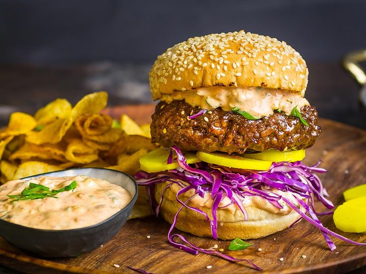 When we want the flavors of Korean bulgogi (grilled marinated beef) and the convenient outdoor grilling method of a burger, there's an easy solution: combine them. By sticking with a classic burger patty, glazing it with a flavorful sauce, and stacking it with spicy kimchi mayo and pickled daikon radish, you can keep the best of both worlds without offending culinary purists.