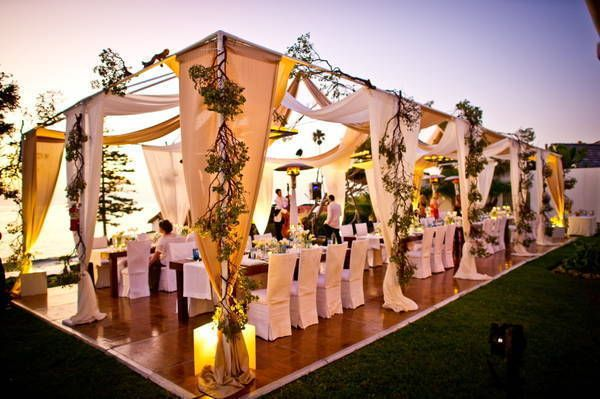 Beautiful! Easily replicated by using a tent frame over dance flooring, swag with fabric/drapes/vines & add some pretty lighting